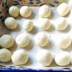 Lemon truffles rolled and chilled.