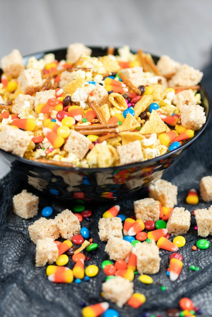 Halloween snack mix in a Halloween bowl.