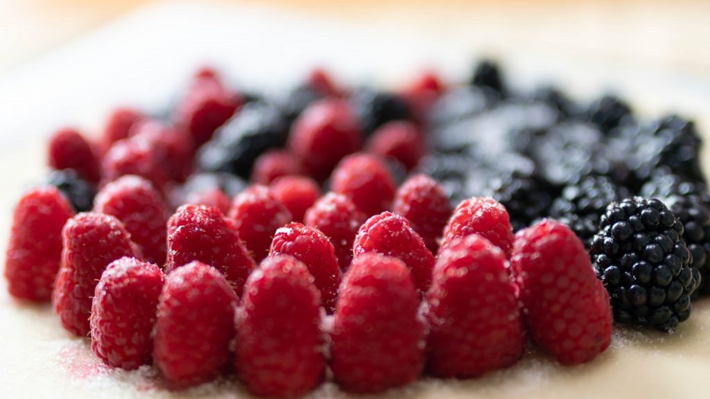 Easy rustic mixed berry tart unbaked with fresh raspberries and blackberries.