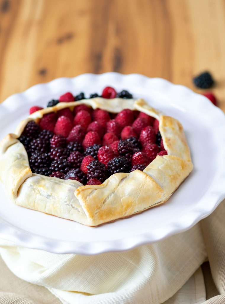 Easy rustic mixed berry tart with the edges folded in baked with a golden crust.