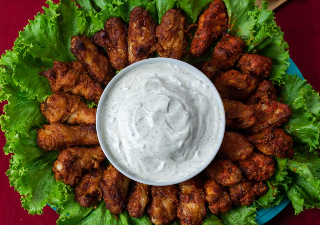 game day party food ideas franks redhot wings buffalo kickin' bbq original lettuce homemade ranch dip red background