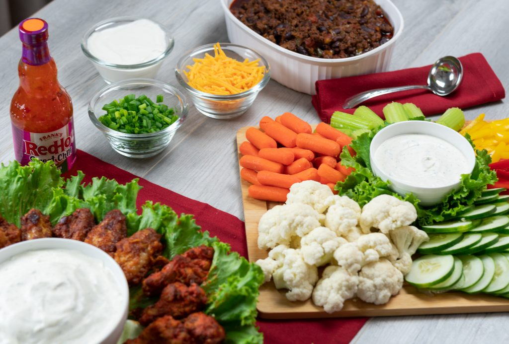 game day party food ideas franks redhot wings buffalo kickin' bbq original lettuce homemade ranch dip red background chili
