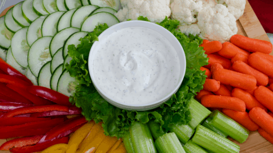 homemade ranch dip vegetable platter carrots red yellow peppers cucumbers celery cauliflower lettuce
