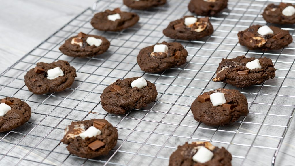 hot cocoa cookies hot chocolate mix mini marshmallows chocolate chunks black plate baker's rack