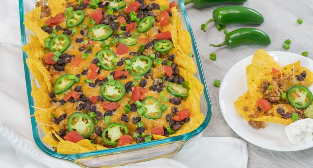 loaded beef nachos with jalapenos, black beans, diced tomatoes, cheese blend, and seasoned beef. Served with yellow corn tortilla chips