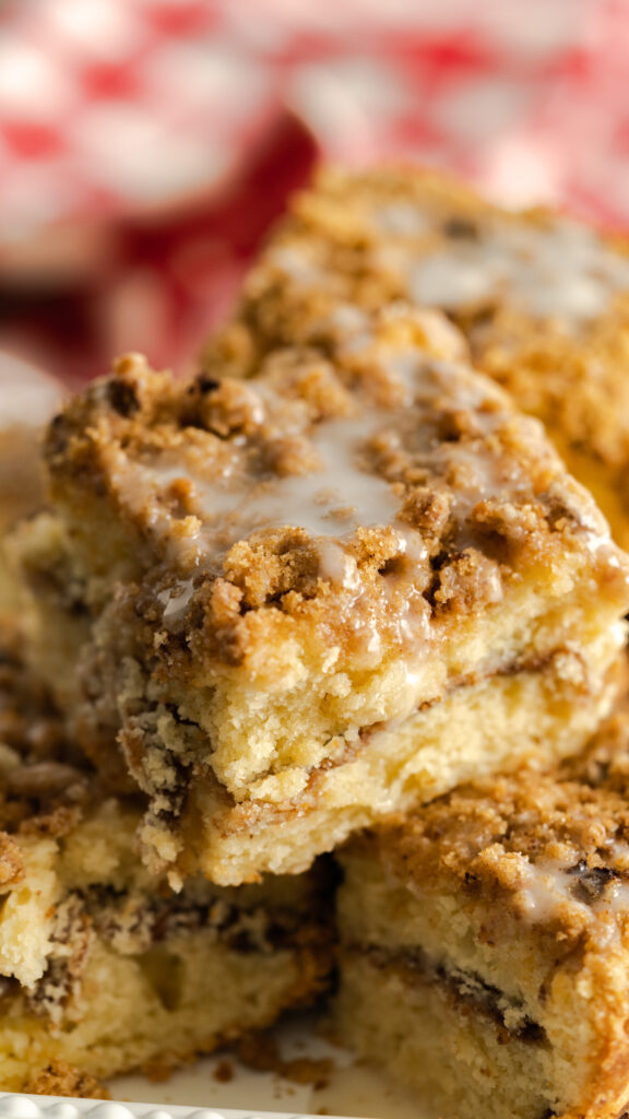 Close up of slices of coffee cake stacked with drizzle.