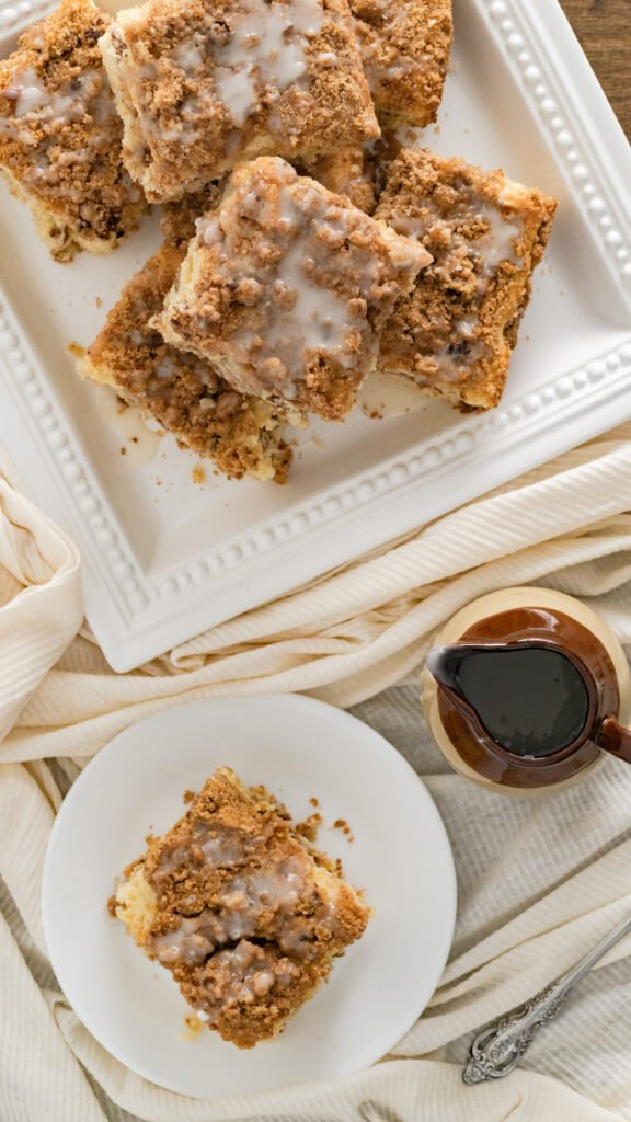 A top view of sliced and stacked sour cream coffee cake.