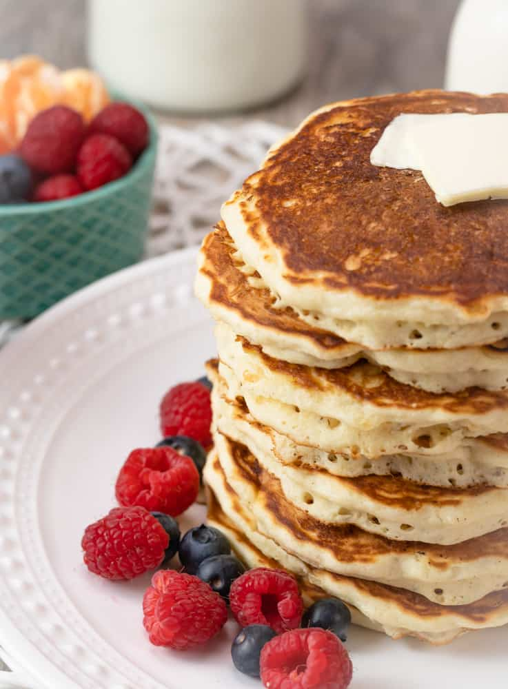 brown butter pancakes without syrup and with a pat of butter
