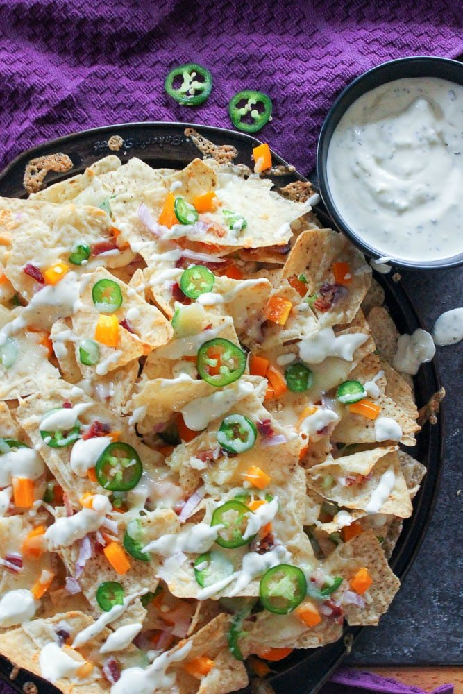 Jalapeno Popper Nachos with Garlic Cream Sauce are the perfect fun recipe for your super bowl party or for tailgating gluten free and oven baked