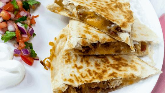 cheesy chicken, bacon, and pico de gallo quesadilla with sour cream