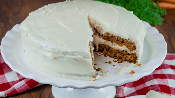Carrot cake with slice taken out with homemade cream cheese frosting