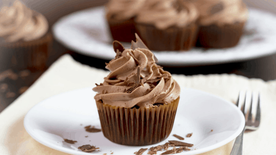chocolate cupcakes with chocolate frosting topped with chocolate shavings
