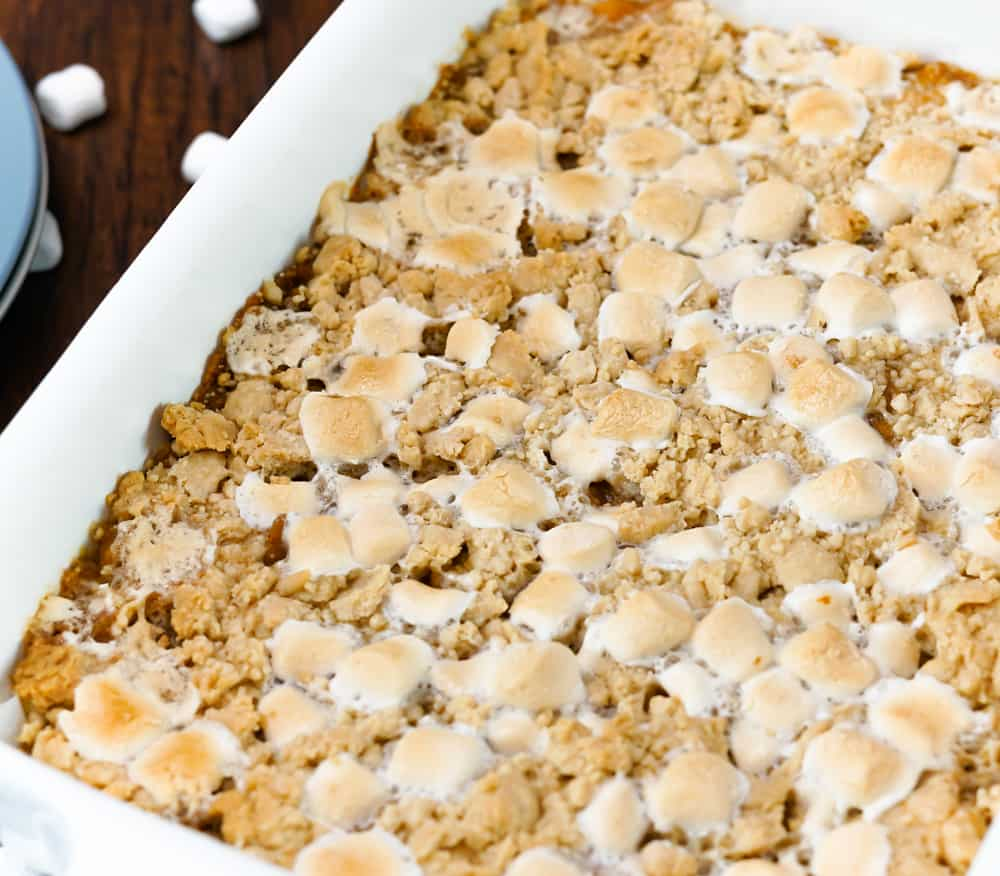 sweet potato casserole with streusel topping and mini marshmallows in a casserole dish