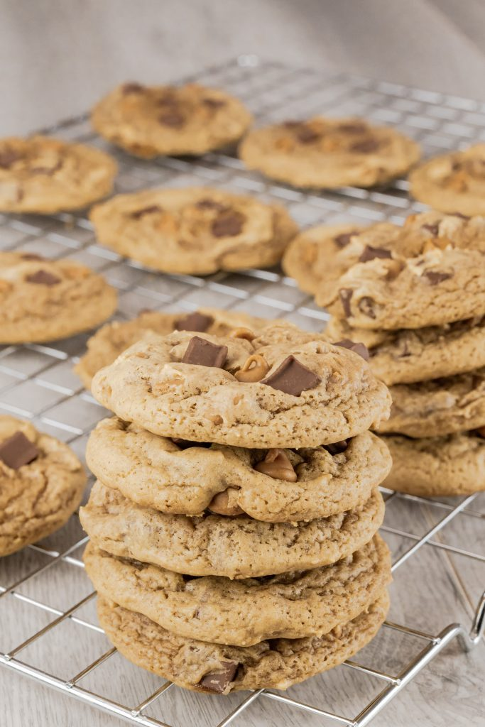 Stacked peanut butter chocolate chunk cookies.
