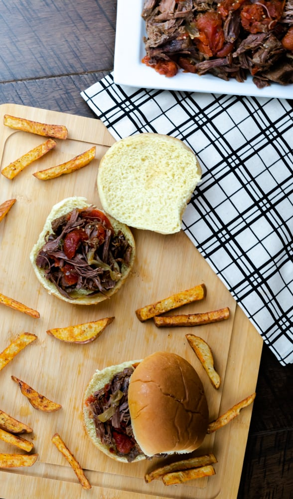 Instant Pot Italian-Style Pot Roast served on a bun and red potato french fries