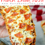 This Air Fryer French Bread Pizza is made using a loaf of French bread. It is brushed with butter and garlic mixture and topped with sauce, pepperoni, and cheese. #airfryerfrenchbreadpizza #airfryerpizza #airfryerrecipes #quicklunch #easylunch #pizza #frenchbreadpizza #