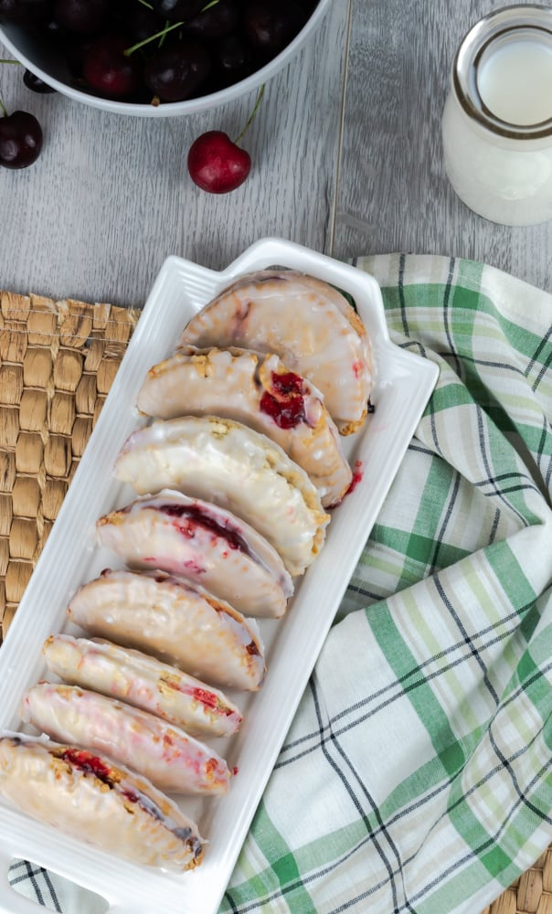 These cherry hand pies are air-fried are made with homemade buttermilk crust and have a sweet glaze. They are made with fresh cherries and with hints of cinnamon. #airfryer #instantpotvortex #instantpot #instantpotairfryer #cherrypies #cherry #freshfruit #handpies #glazed #dessert #easydessert