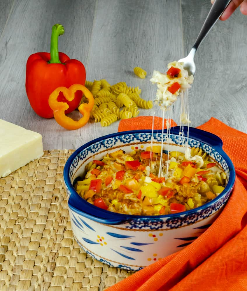 A fork of Santa Fe Chicken Casserole with stringy cheese made in the Instant Pot.