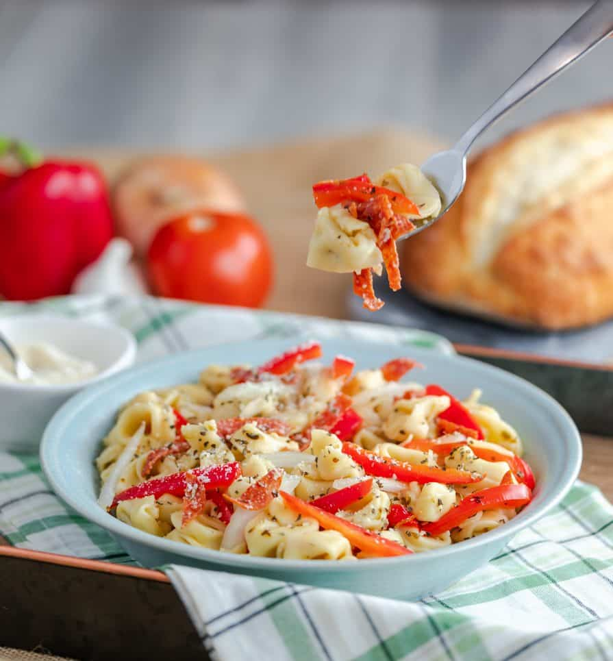 This pasta salad is made with 3 cheese tortellini pasta and has a mixture of peppers, onions, pepperonis, and seasonings. Directions for the Instant Pot (Pressure Cooker) and the stove-top are included!