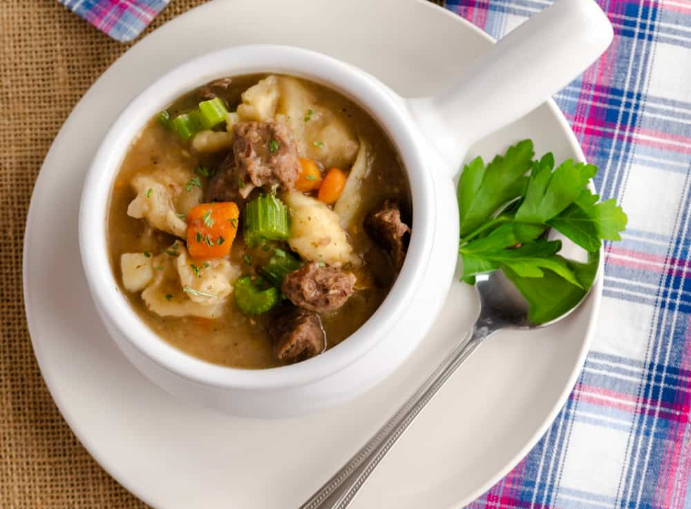 This comforting beef and dumplings are made in the Instant Pot with stew meat, potatoes, celery, onion, and carrots. This meal is ready in less than 1 hour.