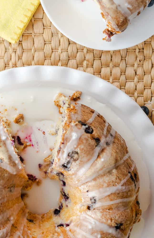 Moist and delicious blueberry pound cake made with yogurt and drizzled with lemon glaze.