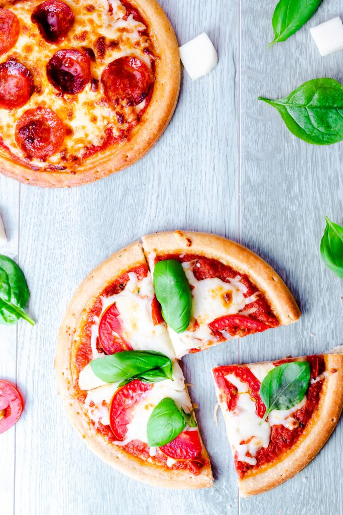 Personal pizzas made with premade crust in the Air Fryer. Included are directions to make pepperoni, Mediterranean, and Margherita Pizza. #airfryerpizza #airfryer #pizzarecipe #pizza #mediterraneanpizza #margheritapizza