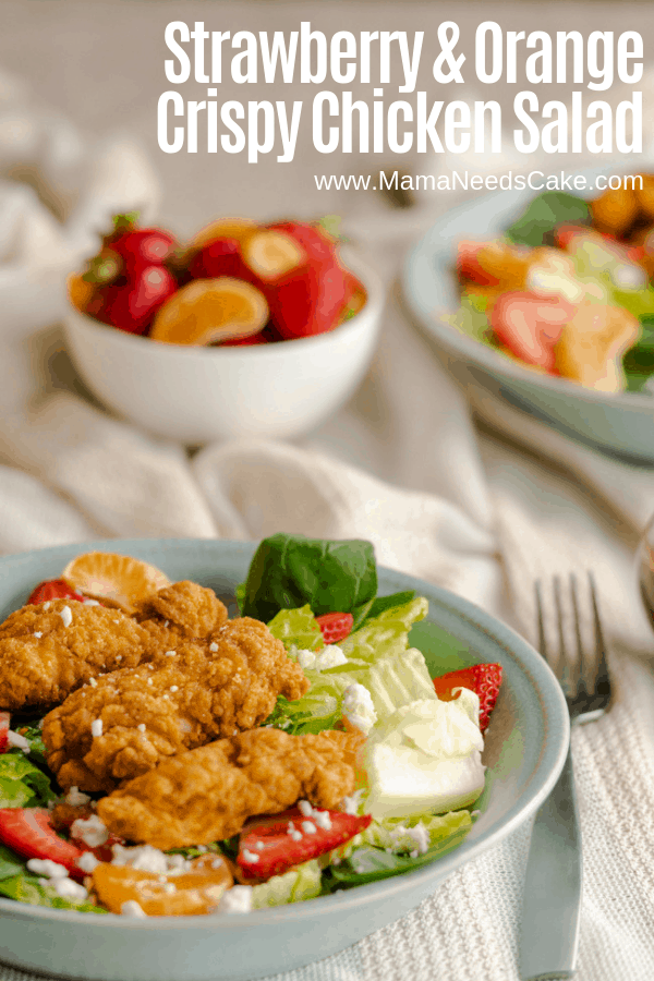 ad Strawberry and Orange Crispy Chicken salad with layers of romaine lettuce and spinach, freshly cut strawberries and oranges, and topped with Tyson® Crispy Chicken Strips, and garnished with feta cheese.
