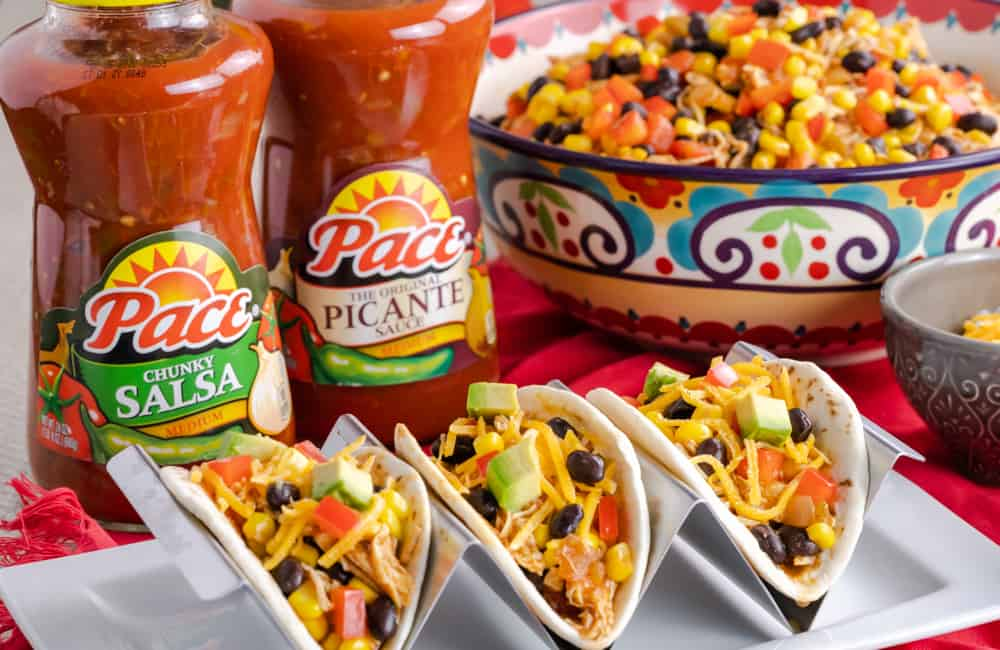 Southwestern shredded chicken tacos made with Picante sauce and tossed with diced red peppers, super sweet corn, and black beans.
