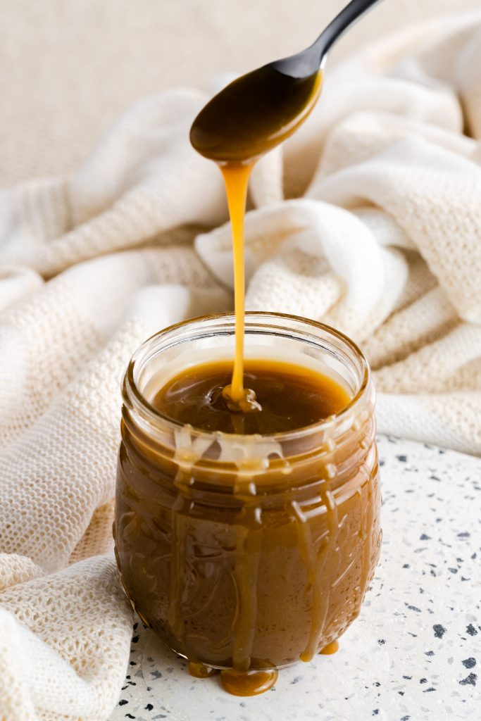 Ooey, gooey, homemade salted caramel sauce great for use as a filling in cupcakes and as drizzling on treats. Tastes great blended into frosting and is delicious on ice cream!
