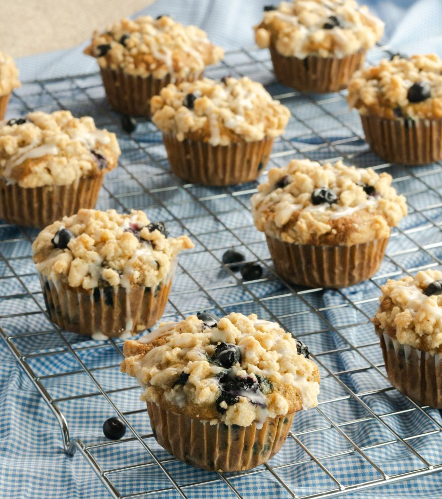 Delicious and moist blueberry banana muffins with a crumb topping and a sweet vanilla glaze.