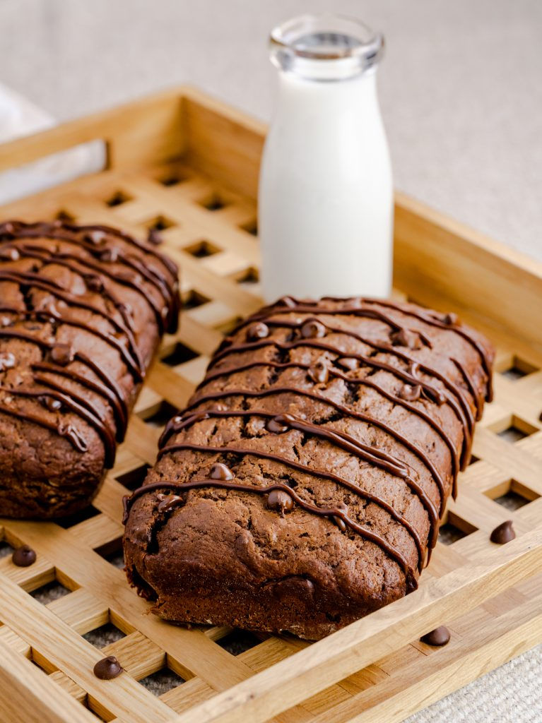 Moist and delicious homemade triple chocolate loaf mixed with chocolate chips and topped with homemade chocolate drizzle.