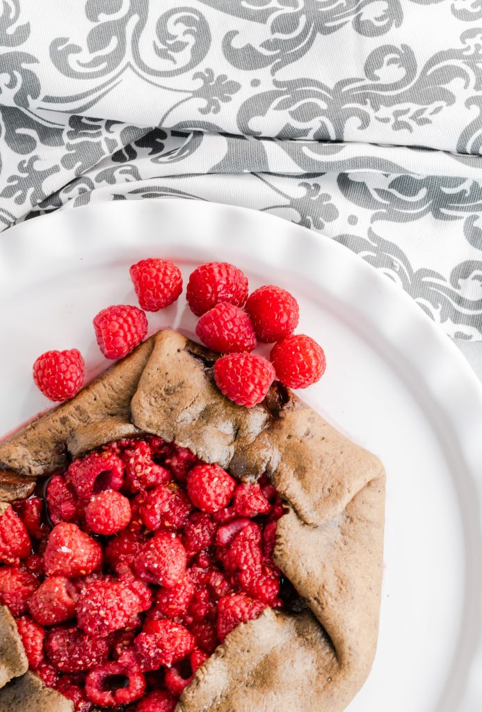 This Chocolate Raspberry Tart has a chocolate crust and is filled with raspberries and brown sugar.