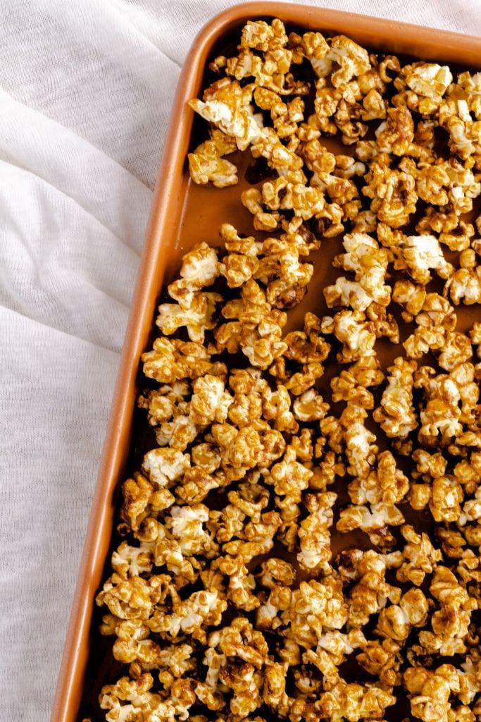 baking sheet with caramel gingerbread popcorn