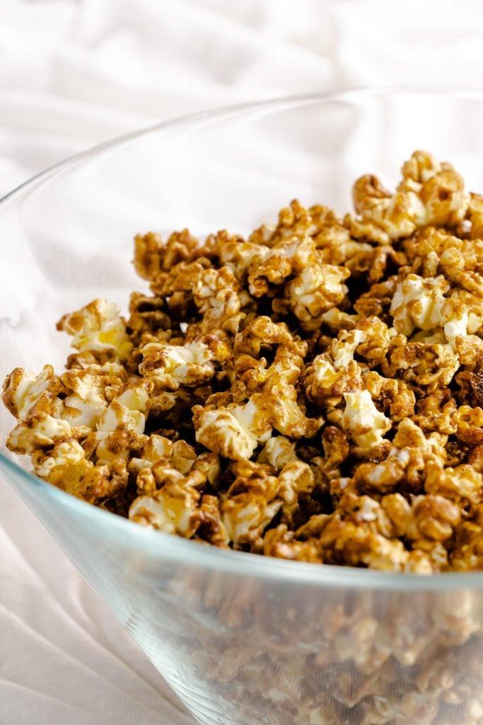 caramel gingerbread popcorn in glass bowl