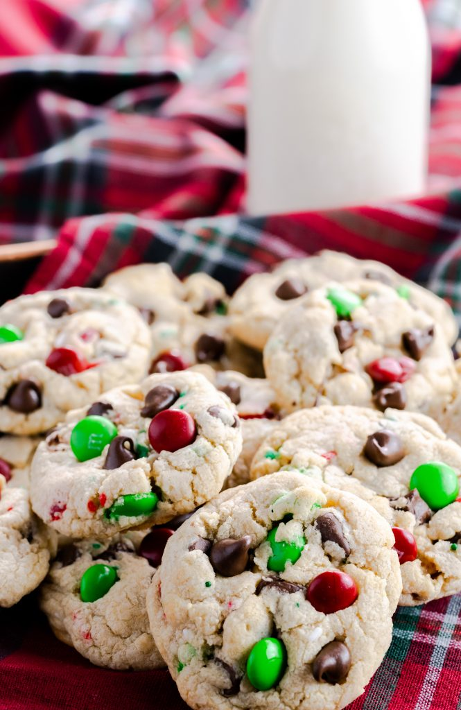 Santa's cookies made with red and green sprinkles, chocolate chips, and red and green M&M's.