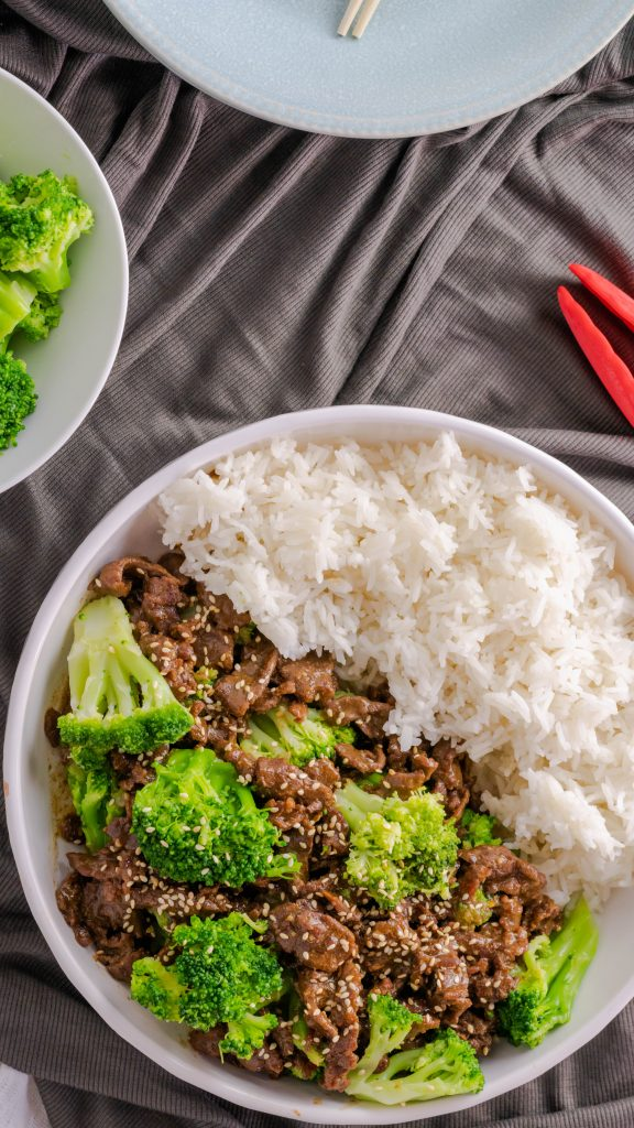 A bowl of beef and broccoli with a side of jasmine rice all made in the Instant Pot.