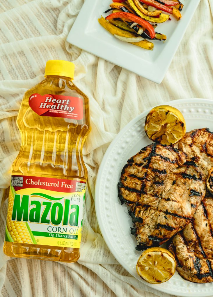 Grilled honey glazed chicken on a serving plate.