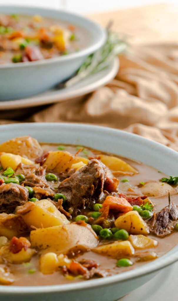 A bowl of homemade pressure-cooker beef stew made in the Instant Pot.