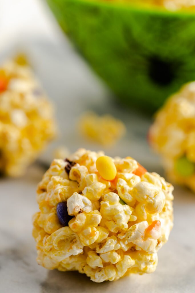 Candy corn popcorn balls with Halloween M&M's.