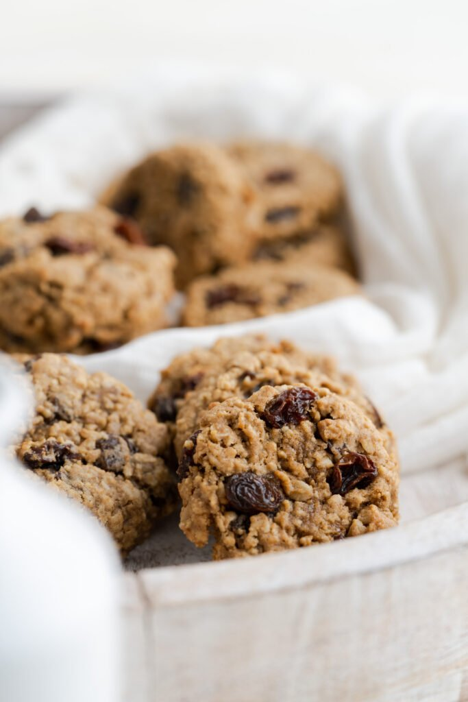 Oatmeal cookies with raisins on a serving platter.