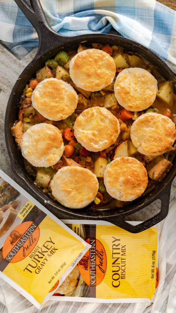 Pot Pie with biscuit topping in cast iron skillet.