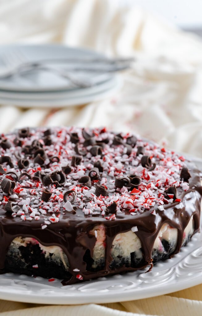 Instant Pot Peppermint Cheesecake garnished with peppermint candies and chocolate curls.