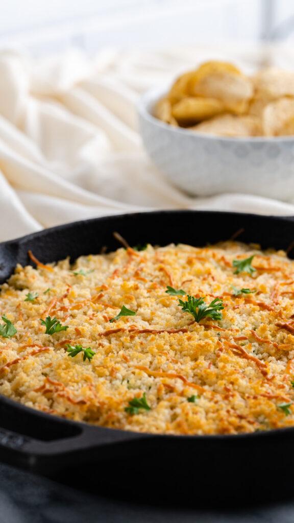 Sausage Jalapeño Dip served with panko and parsley.
