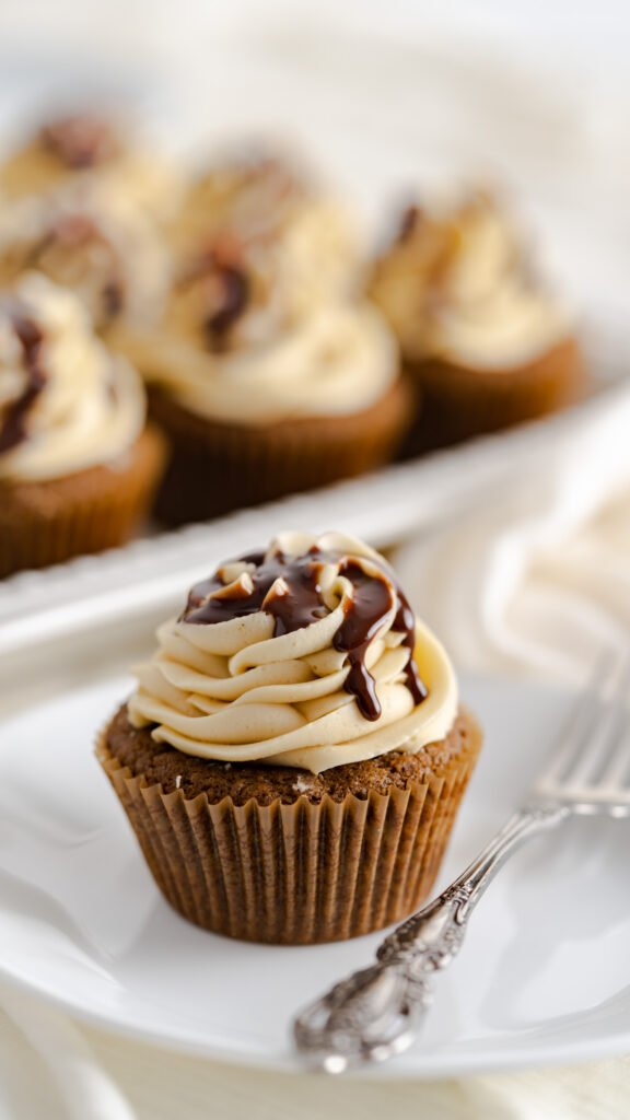 Chocolate gingerbread cupcake with gingerbread frosting and drizzled with ganache.