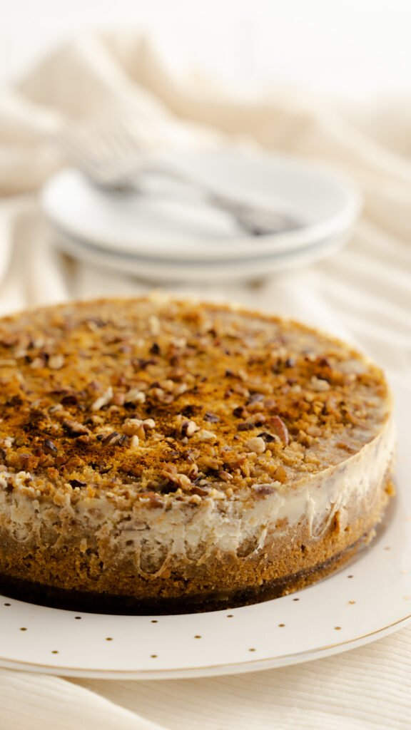 Butter pecan cheesecake on serving plate.