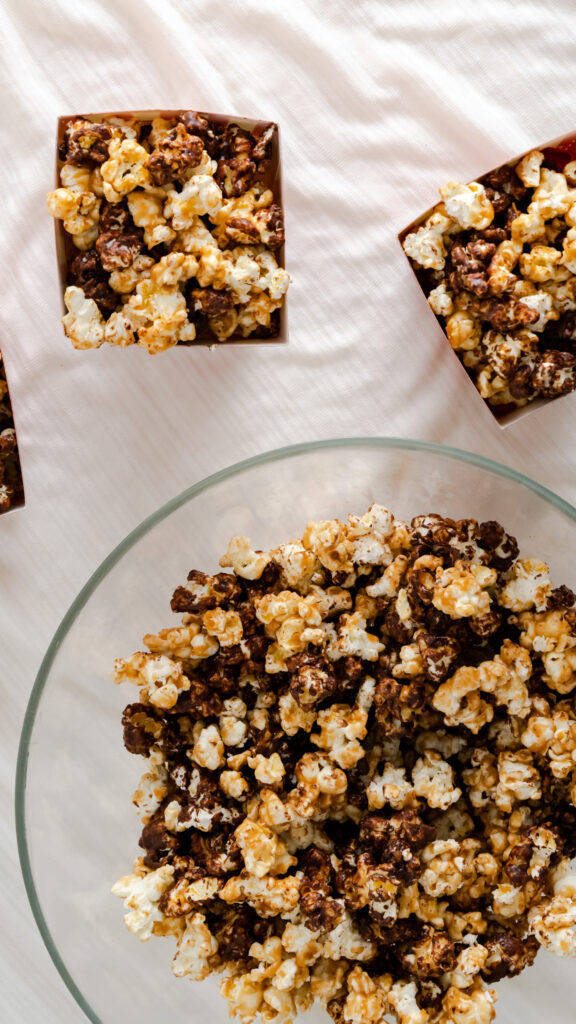 Chocolate popcorn and caramel popcorn in glass serving bowls