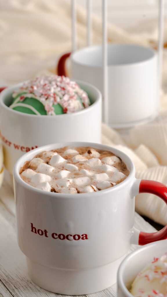 melted hot chocolate bomb in hot water inside of white mug