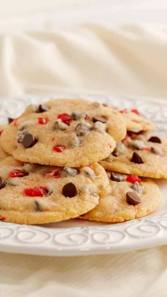 stacked cherry chocolate cookies on white decorative plate