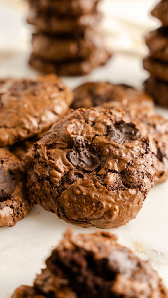 Closeup of chocolate flourless cookie with melted chocolate chips.