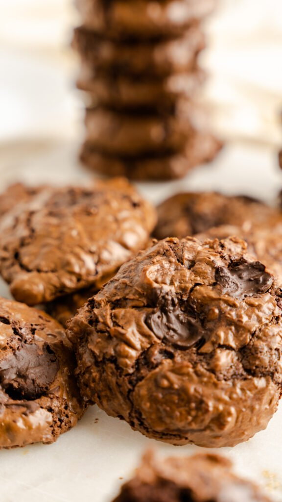 Close up of chocolate cookies with melted chocolate chips.